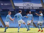 bek-inggris-manchester-city-john-stones-2l-merayakan-mencetak-gol-kedua-timnya.jpg