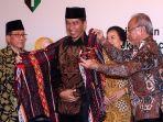 Luncurkan Beli Kreatif Danau Toba, Presiden Jokowi: Kain Ulos dan Kopi Sidikalang Sudah Mendunia