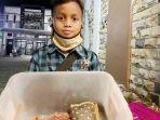 bocah-bernama-ari-wijanoko-berumur-9-tahun-yang-berjualan-sumpia-2.jpg