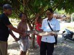 buaya-dengan-panjang-2-meter-terjaring-jala-warga-desa-sekoci-kecamatan.jpg