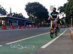 cfd-masih-ditiadakan-warga-bersepeda-di-jalan-sudirman_20200614_233407.jpg