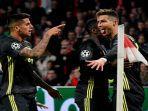cristiano-ronaldo-merayakan-gol-dalam-laga-ajax-vs-juventus-leg-pertama-liga-champions.jpg
