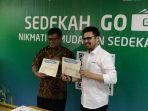 deputi-baznas-arifin-purwakananta-bersama-managing-director-go-pay-budi-ganda-soebrata_20180517_082237.jpg