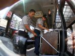 dishub-pekanbaru-sterilisasi-bus-tmp_20200317_172955.jpg