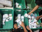 distribusi-paket-obat-gratis-untuk-pasien-covid-19-isolasi-mandi_20210719_212806.jpg