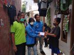 dpp-komite-nasional-pemuda-indonesia-knpi-memberikan-bantu.jpg