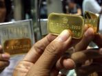 emas-batangan-produksi-pt-aneka-tambang-persero-tbk_20170316_095259.jpg