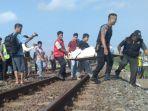evakuasi-jasad-perempuan-yang-tertabrak-prameks_20171006_135721.jpg