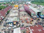 foto-udara-bangunan-hancur-akibat-gempa_20161208_122543.jpg