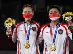 greysia-polli-dan-apriyani-rahayu-raih-emas-olimpiade-badminton_20210802_190602.jpg