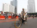 hari-bebas-kendaraan-bermotor-upaya-kurangi-polusi_20181111_204952.jpg