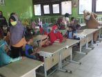 hari-pertama-masuk-sekolah-ajaran-2020-2021-di-tengah-pandemi-co_20200713_174247.jpg