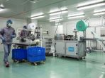 hongkong-produksi-masal-masker-cegah-wabah-virus-corona_20200221_151521.jpg