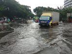 hujan-ekstrem-jalan-daan-mogot-tergenang-air_20200225_093544.jpg