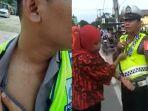 ibu-ibu-cakar-leher-seorang-polisi-dan-adu-mulut-dengan-petugas-tak-terima-hanya-ia-yang-ditilang_20181005_113329.jpg