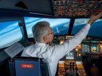 ilustrasi-pilot-yang-sedang-bekerja-di-pesawat.jpg