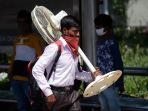 india-berlakukan-lockdown-ribuan-pekerja-migran-berusaha-mudik_20200329_225540.jpg