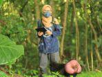indiratendi-saat-sedang-melakukan-penelitian-tentang-monyet-yaki-di-cagar-alam-tangkoko-ggsa.jpg