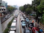 jalan-mampang-prapatan-jakarta-macet-usai-hujan_20210219_134731.jpg