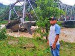 jembatan-sinandaka-di-bolsel-putus-akibat-banjir.jpg