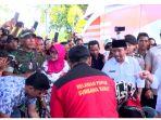 jokowi-serahkan-bantuan-ke-lombok_1_20181019_084924.jpg