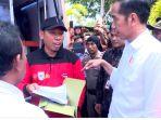jokowi-serahkan-bantuan-ke-lombok_20181019_084857.jpg