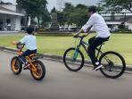jokowi-tampak-bersepeda-bersama-cucunya-gggg.jpg