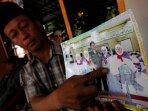 kaharuddin-perlihatkan-foto-ibundanya-korban-tragedi-mina_20151002_213235.jpg