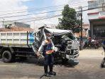 kecelakaan-terjadi-di-jalan-raya-cibanteng-bogor-satu-sopir-truk-terjepit.jpg