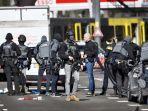 kepolisian-utrecht-mengamankan-lokasi-penembakan-di-utrecht-belanda.jpg