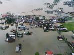 kondisi-banjir-makassar-dilihat-dari-kamera-drone_20190124_000232.jpg