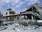 kondisi-gedung-yang-runtuh-di-suriah-akibat-serangan-bom_20180415_130429.jpg