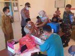 laskar-sasak-gelar-vaksinasi-massal-di-lombok.jpg