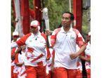 legenda-bulutangkis-indonesia-verawaty-wiharjo-saat-membawa-obor-asian-games.jpg