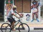 lukisan-mural-ajakan-lawan-covid-19-yogjakarta_20201201_141508.jpg