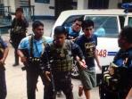 m-sofyan-sandera-abu-sayyaf-asal-takalar-di-kantor-polisi-filipina_20160819_110931.jpg