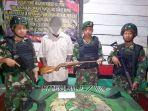 mantan-simpatisan-opm-serahkan-senjata-kepada-satgas-yonif-411-k_20200224_131712.jpg