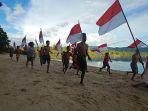 masyarakat-papua-meriahkan-hut-kemerdekaan-ri-ke-76-dengan-gelar_20210818_204510.jpg