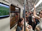 menonton-laga-piala-dunia-2018-di-gerbong-metro-moskow_20180626_132540.jpg