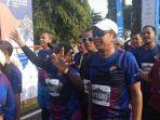 menteri-rini-soemarno-ikut-mandiri-jogja-marathon-2019.jpg