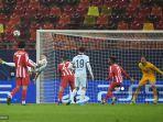 olivier-giroud-kiri-mencetak-gol-pada-pertandingan-leg-pertama-babak-16-besar-liga-champions.jpg
