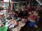 omzet-pedagang-pasar-tradisional-menurun_20210722_140508.jpg