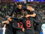 para-pemain-atletico-madrid-berselebrasi-usai-cetak-gol-melawan-lokomotiv-moskva.jpg