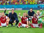 para-pemain-austria-merayakan-kemenangan-setelah-memenangkan-pertandingan.jpg