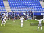 para-pemain-real-madrid-merayakan-setelah-mencetak-gol.jpg