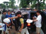 para-pencari-suaka-menerima-bantuan-berupa-makanan-matang_20180603_194752.jpg