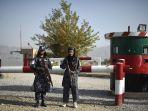 pasukan-taliban-berperan-sebagai-polisi-afghanistan_20211006_201136.jpg
