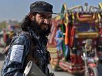 pasukan-taliban-berperan-sebagai-polisi-afghanistan_20211006_201420.jpg