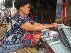 pedagang-alat-bakar-sate-di-pasar-kramatjati-jakarta-timur_20170901_153725.jpg