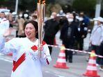 pelari-estafet-obor-olimpiade-di-fukushima.jpg